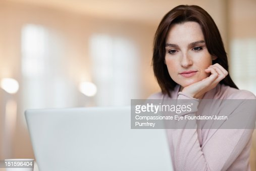 Woman using laptop, close up : Bildbanksbilder