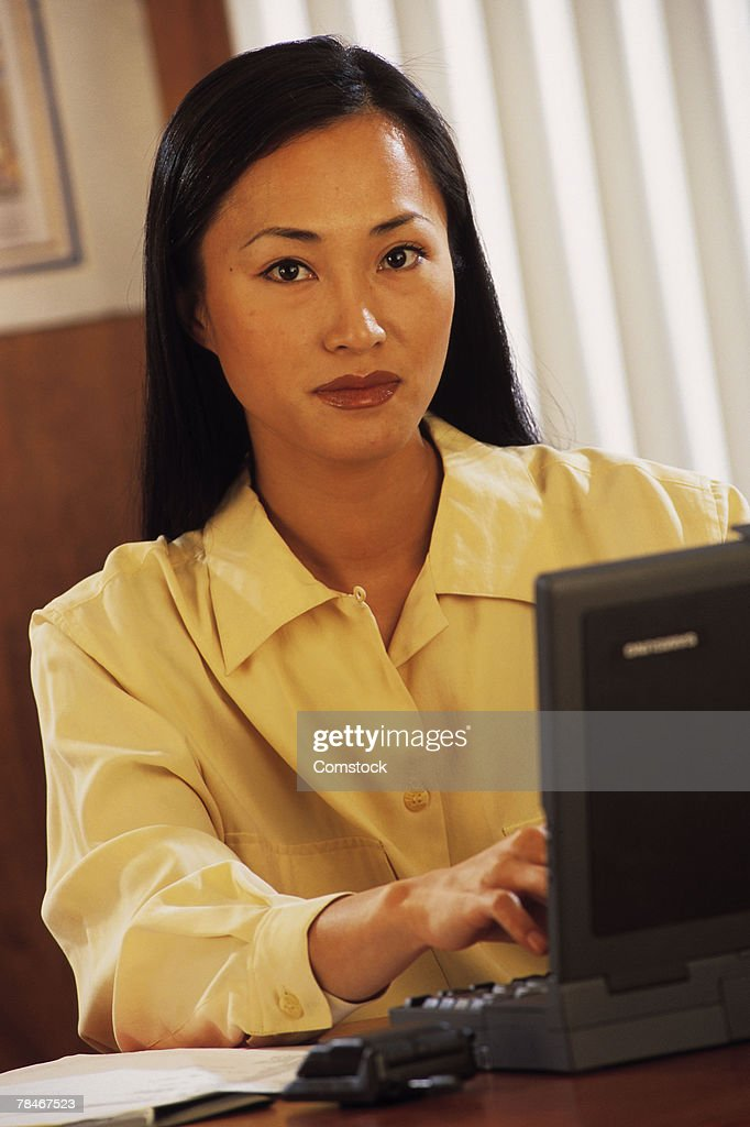 Woman using laptop computer in office : Stock Photo