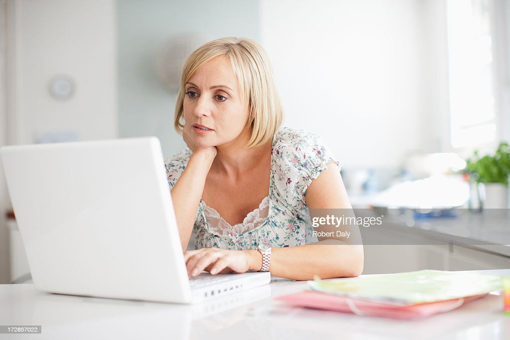 Woman using laptop : Stock Photo
