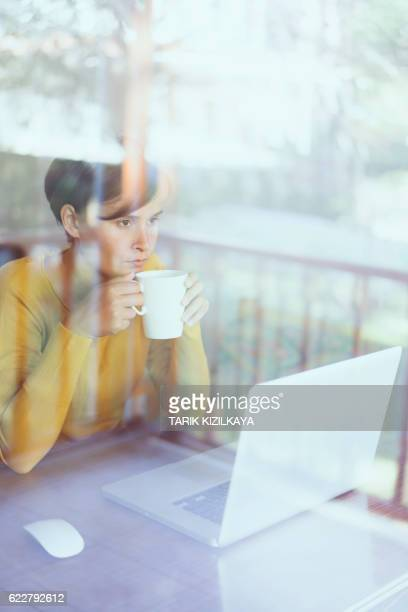 Woman using laptop, working home office