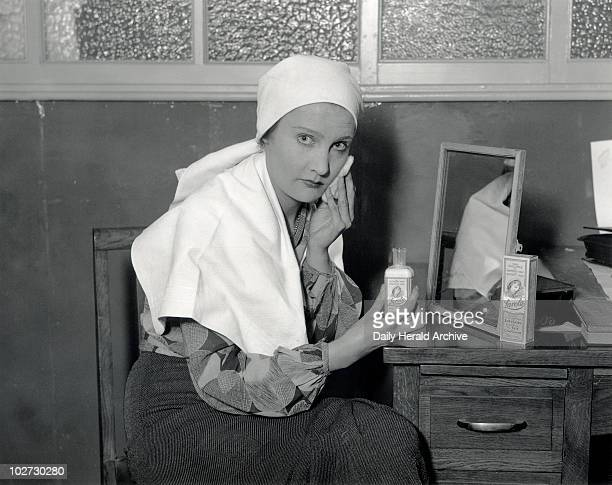 A woman using Larola face cream 30 October 1931 An advertising picture for Larola's facial lotion Photograph by Daily Herald staff photographer...