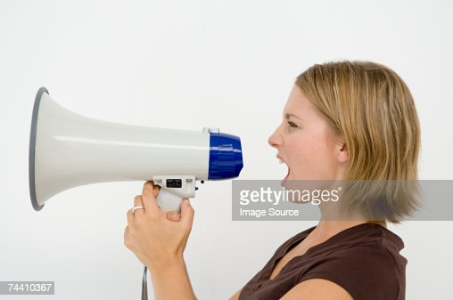 Woman using loudspeaker : Stock Photo