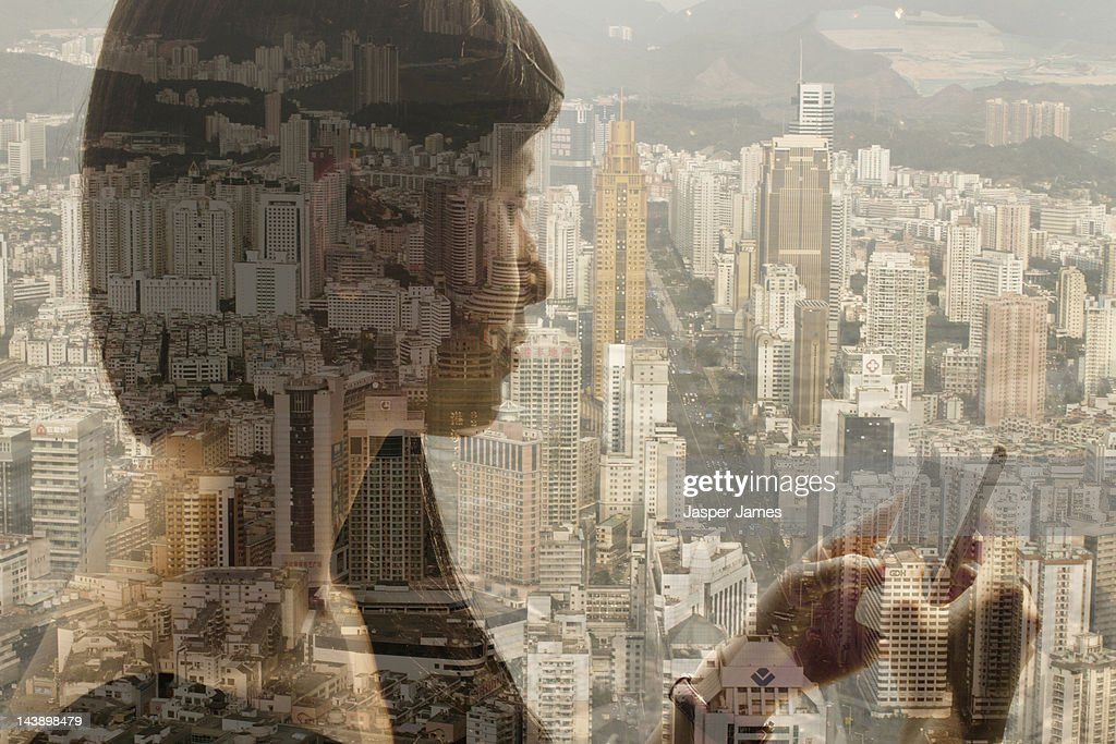 woman using mobile phone and cityscape : Stock Photo