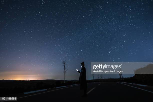 Woman Using Mobile Phone in Starry night
