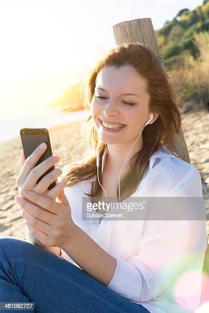 Woman Using Mobile phone on Beach