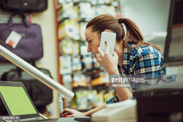 woman using on smart phone in store.