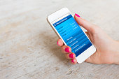 Woman using online banking website on smartphone