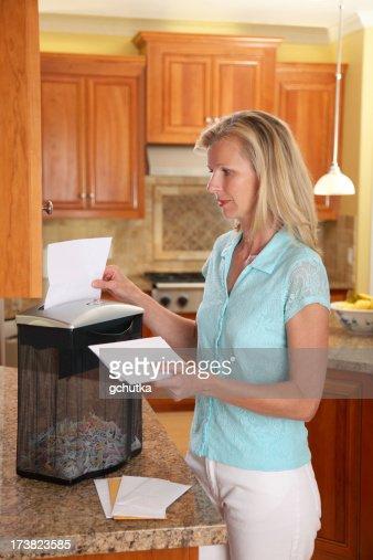 Woman Using Paper Shredder