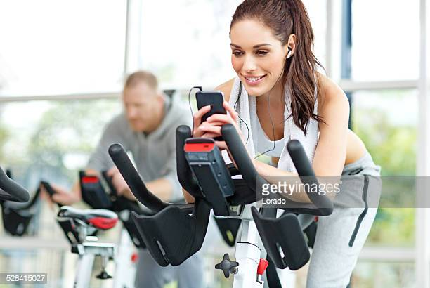 woman using phone during sports training