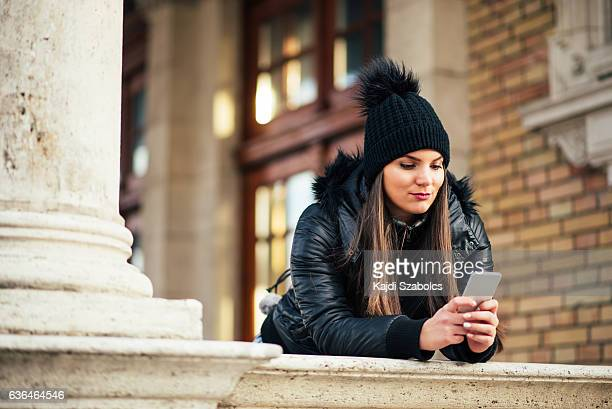 woman using phone in Budapest