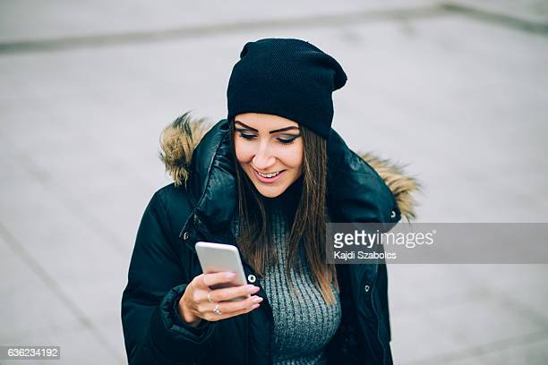 woman using phone in city