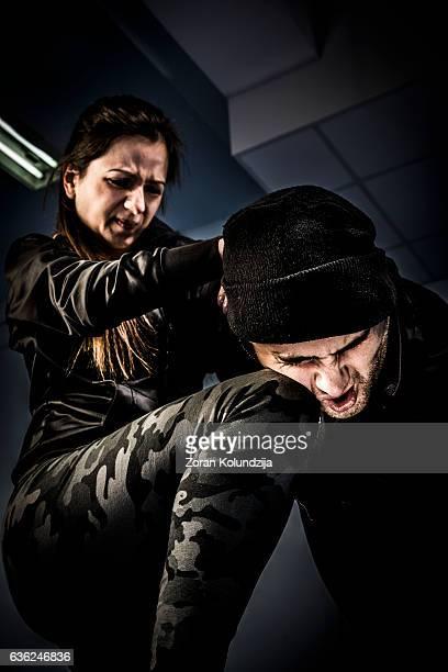 Woman using self defense technique against attacker