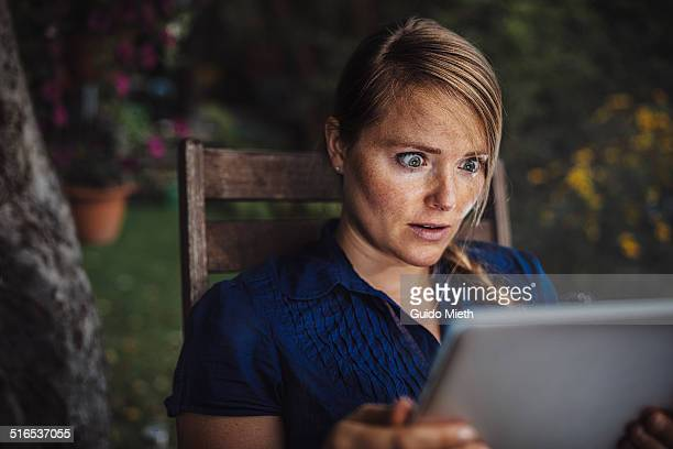 Woman using smart device.