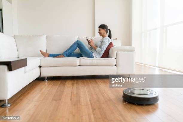 Woman using smart home technologies