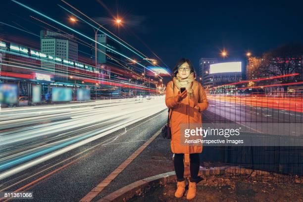 Woman using Smart Phone in urban city