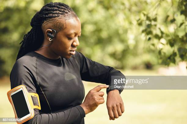 Woman using smart watch to monitor her performance