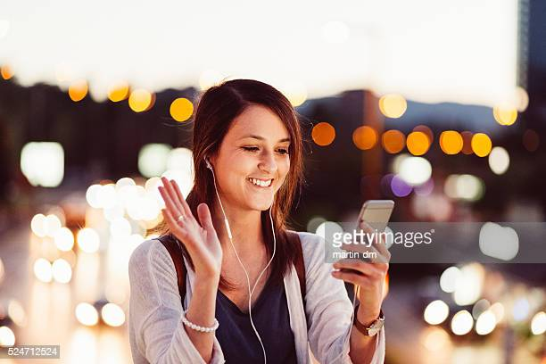 Woman using smartphone for video call