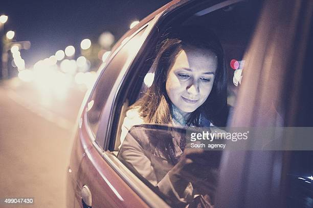 Woman using smartphone in the car