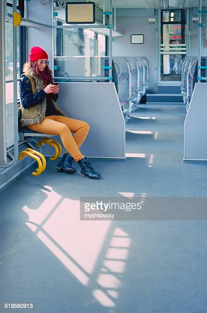 Woman using smartphone in train