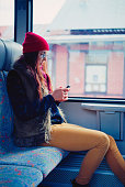 Woman using smartphone in train.