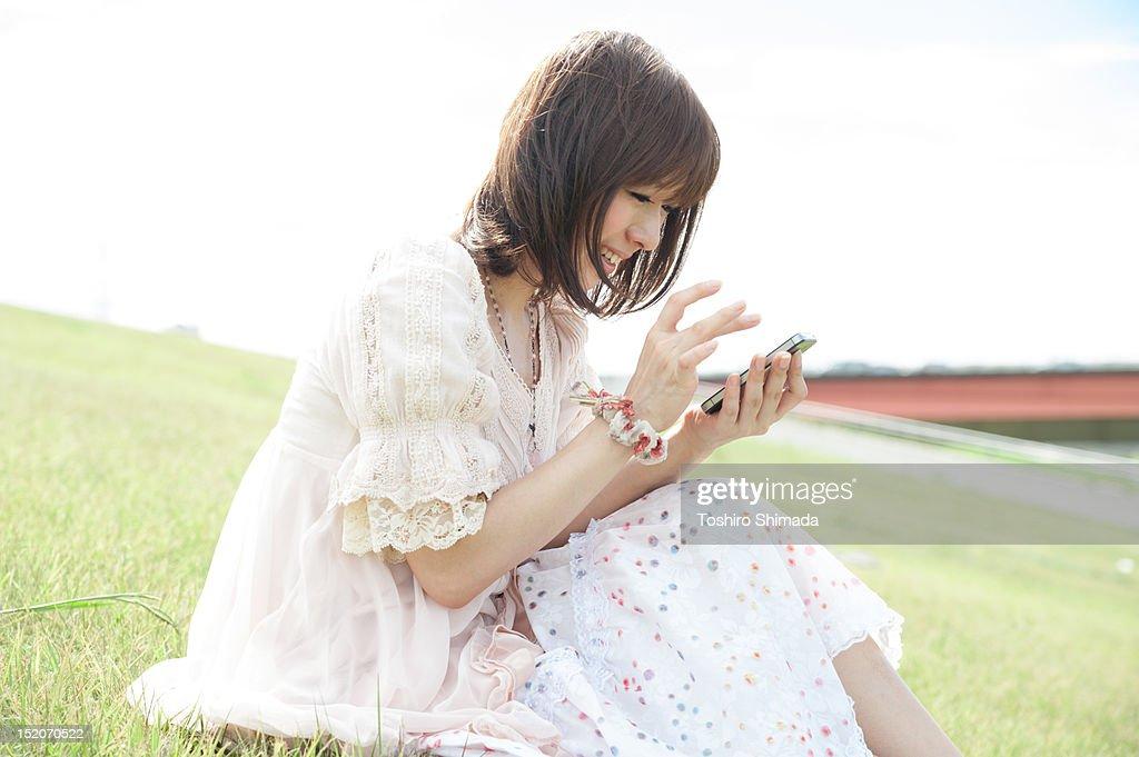 Woman using smartphone : Stock Photo