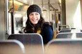 Woman using streetcar in city.