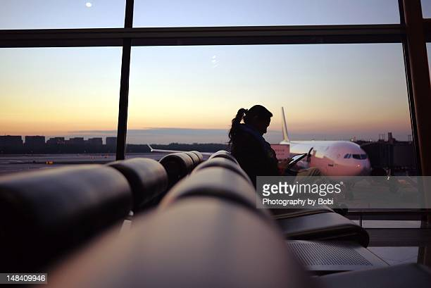 Woman using tablet at airport