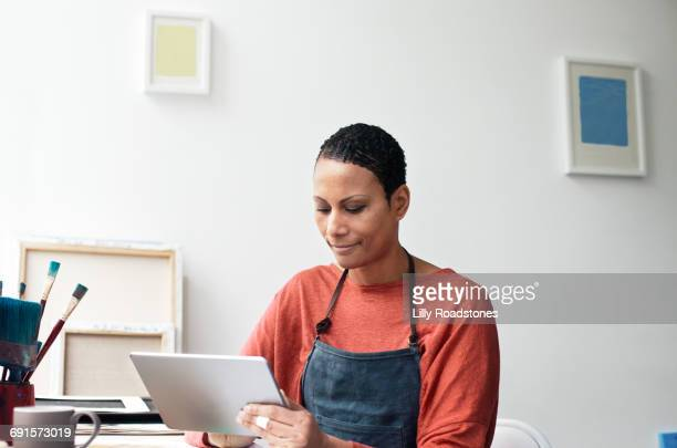 Woman using tablet computer in studio