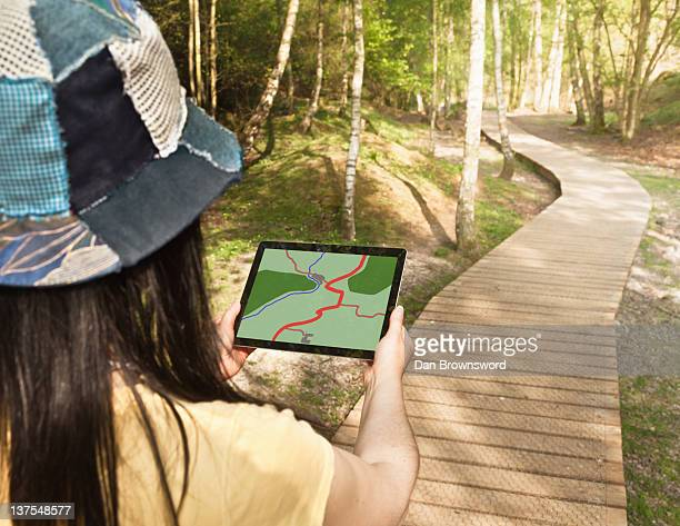 Woman using tablet computer while hiking