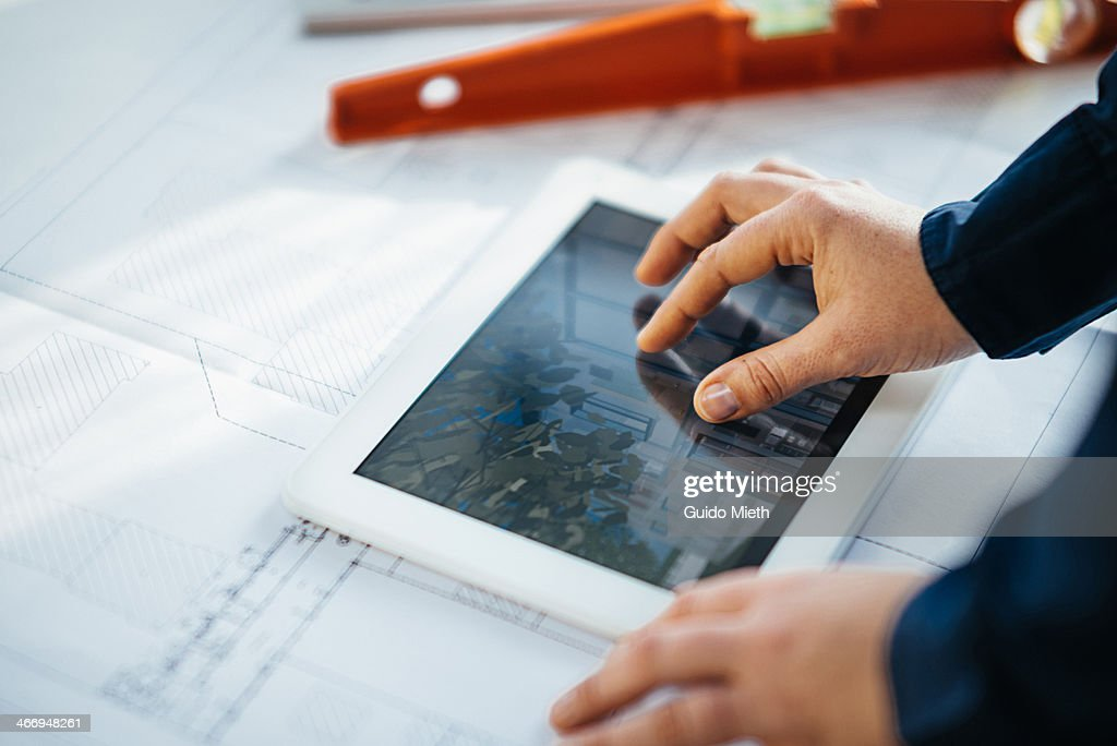 Woman using tablet in architecture office : Stock Photo