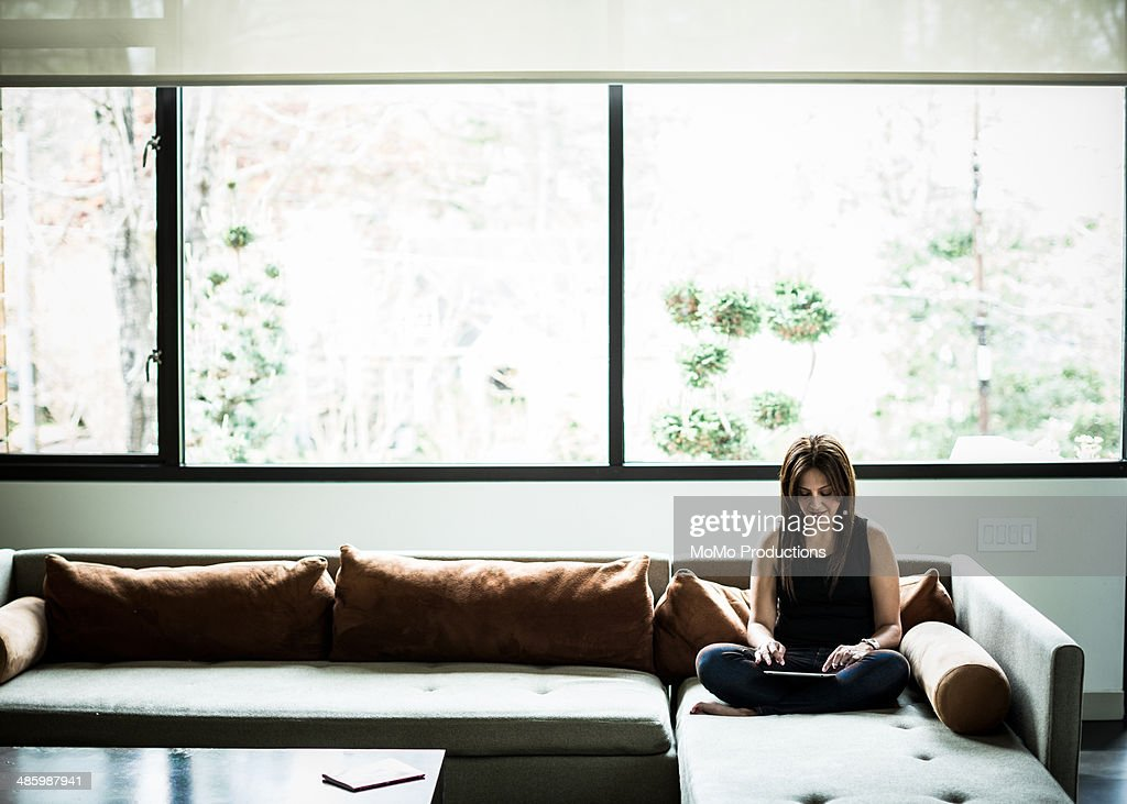 woman using tablet on couch : Stock Photo