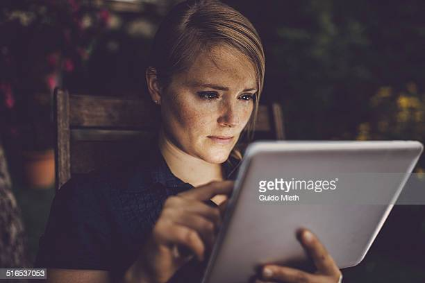 Woman using tablet outdoor.
