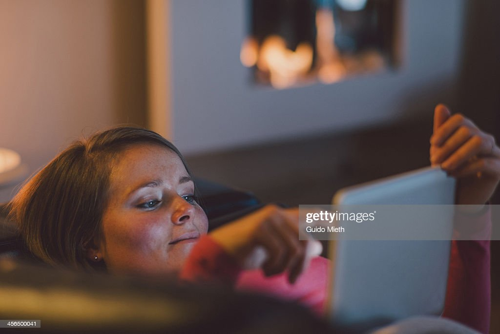 Woman using tablet pc at home. : Stock Photo