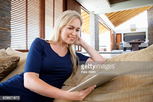 Woman using tablet pc at home : Photo