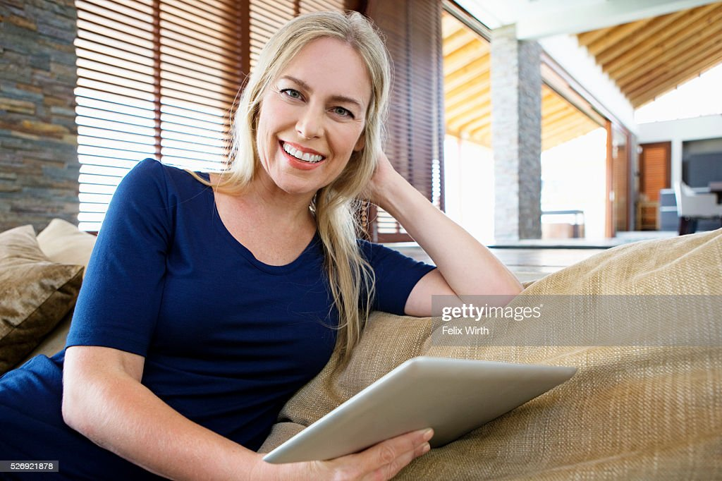 Woman using tablet pc at home : Stock Photo