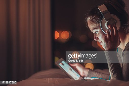 Woman using tablet pc in evening.