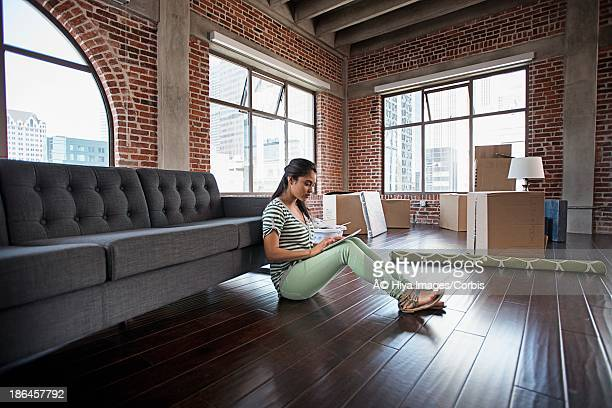 Woman using tablet PC in new apartment