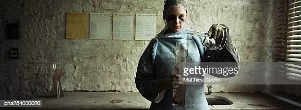 Woman using test tubes