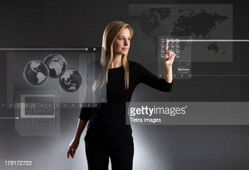 Woman using touchscreen with global data