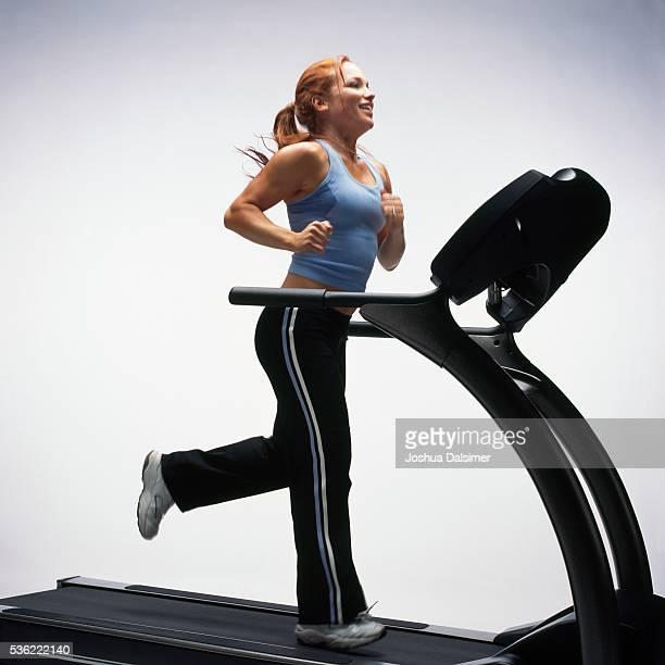 Woman using treadmill
