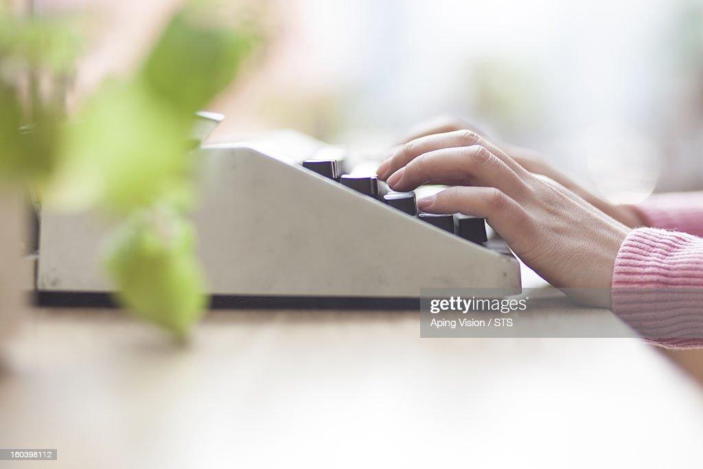 woman using typewriter : Stock Photo