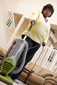 Woman using vacuum