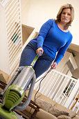 Woman using vacuum