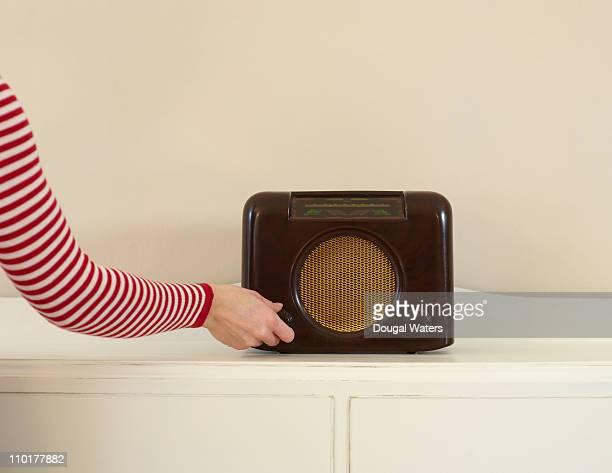 Woman using vintage radio