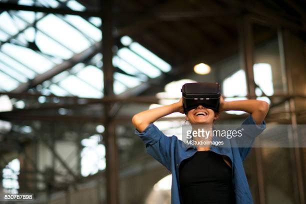 Woman using virtual realty simulator