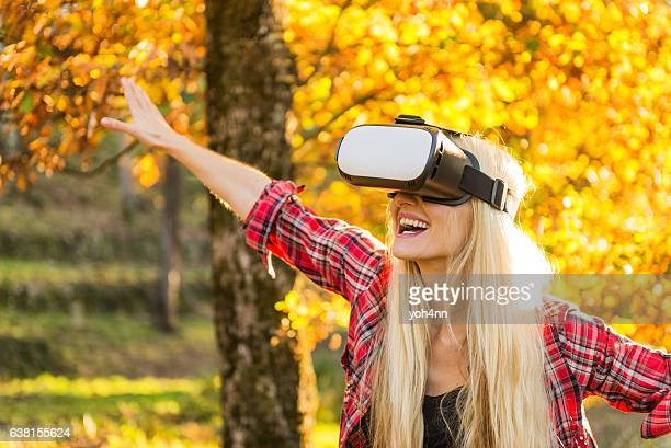 Woman using VR headset & laughing