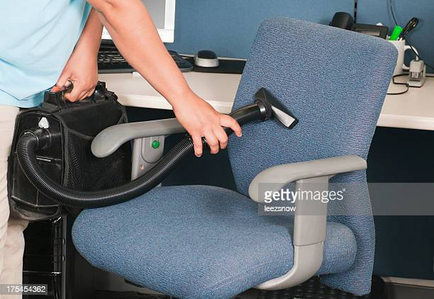 Woman Vacuuming Chair Upholstery
