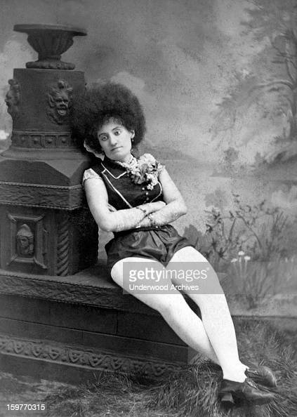 A woman vaudeville performer sits morosely for a portrait Chicago Illinois c 1880