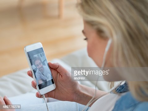 Woman video chatting on her cell phone