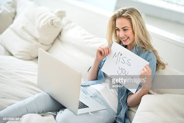 Woman video chatting with her distant boyfriend
